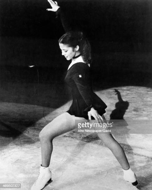 A full length portrait of figure skater Tai Babilonia on the ice 1980