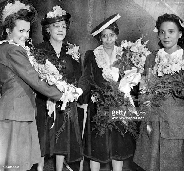Full length portrait of, from left to right, Miss Hilda Proctor of Yonkers, New York, Mrs Mary Cornish of Chester, Pennsylvania, Mrs E S Northup,...