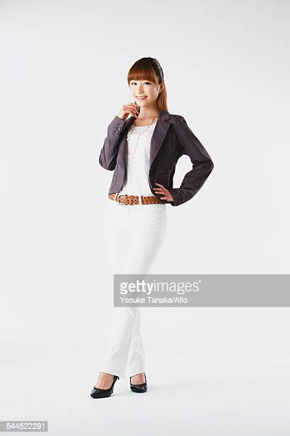 Full length portrait of Japanese young businesswoman against white background
