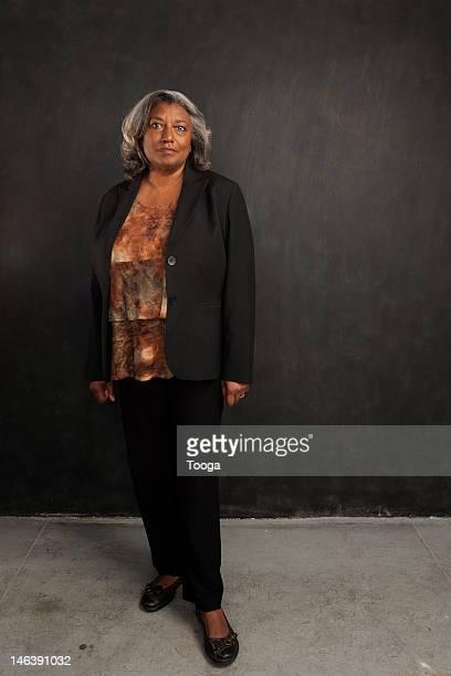 Full length portrait of senior woman