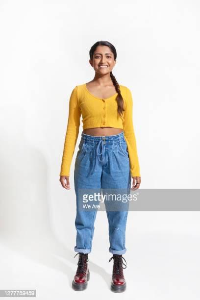 full length portrait of smiling woman - vertical fotografías e imágenes de stock