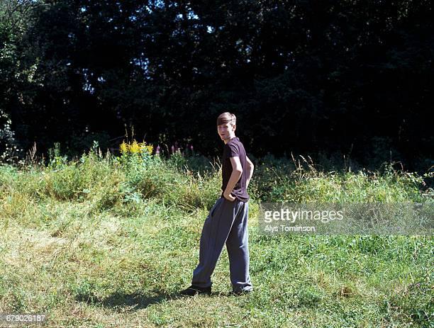 Full length portrait of teenage boy in park