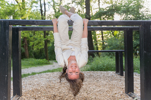 Full Length Portrait Of Woman Hanging Upside Down On Metallic Bar At Park - gettyimageskorea