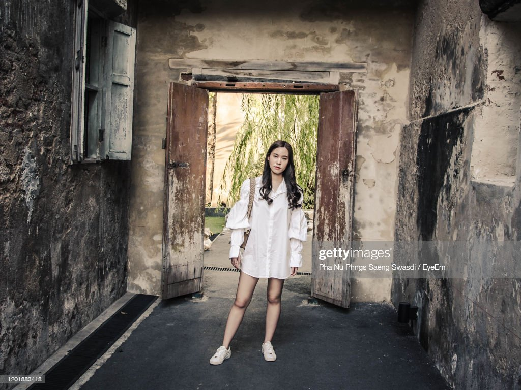 Full Length Portrait Of Woman Standing In Abandoned Building High Res Stock Photo Getty Images