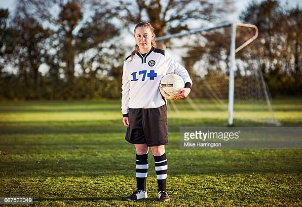 Full length portrait of young female footballer