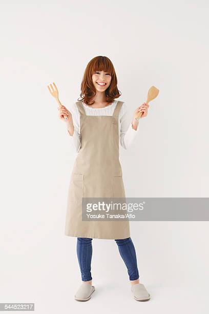 full length portrait of young japanese woman against white background - homemaker stock pictures, royalty-free photos & images