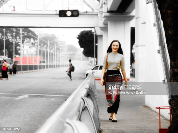 full length portrait of young woman in city - ko ko htike aung stock pictures, royalty-free photos & images