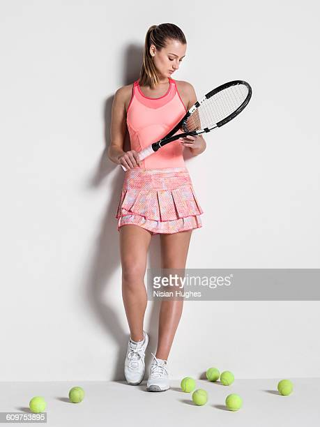 Full length portrait of young woman tennis player