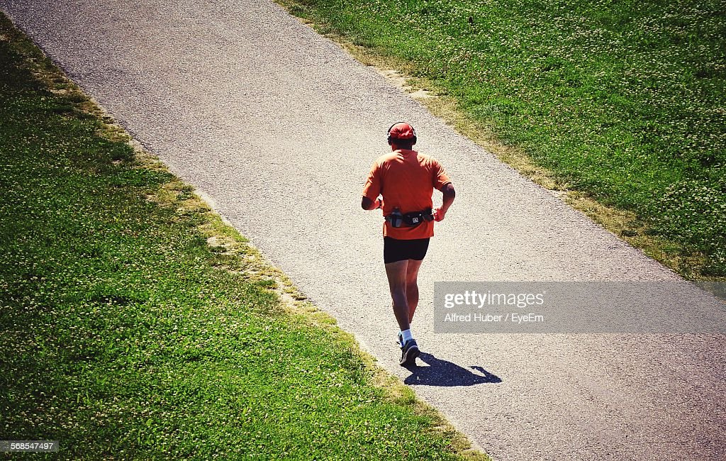 Full Length Rear View Of Man Running On Road : Stock Photo