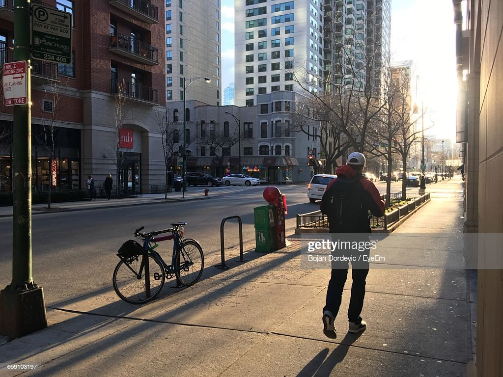 Full Length Rear View Of Man Running On Sidewalk In City At Morning : Stock Photo