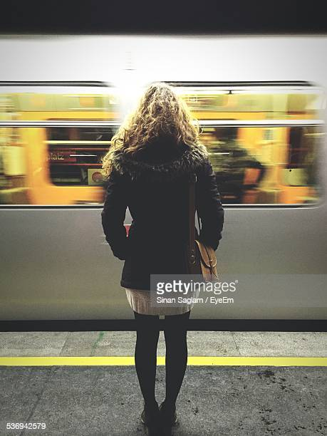Full Length Rear View Of Woman On Subway Platform Against Train