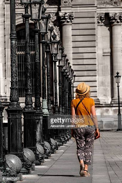 Full Length Rear View Of Woman Walking Against Historic Building
