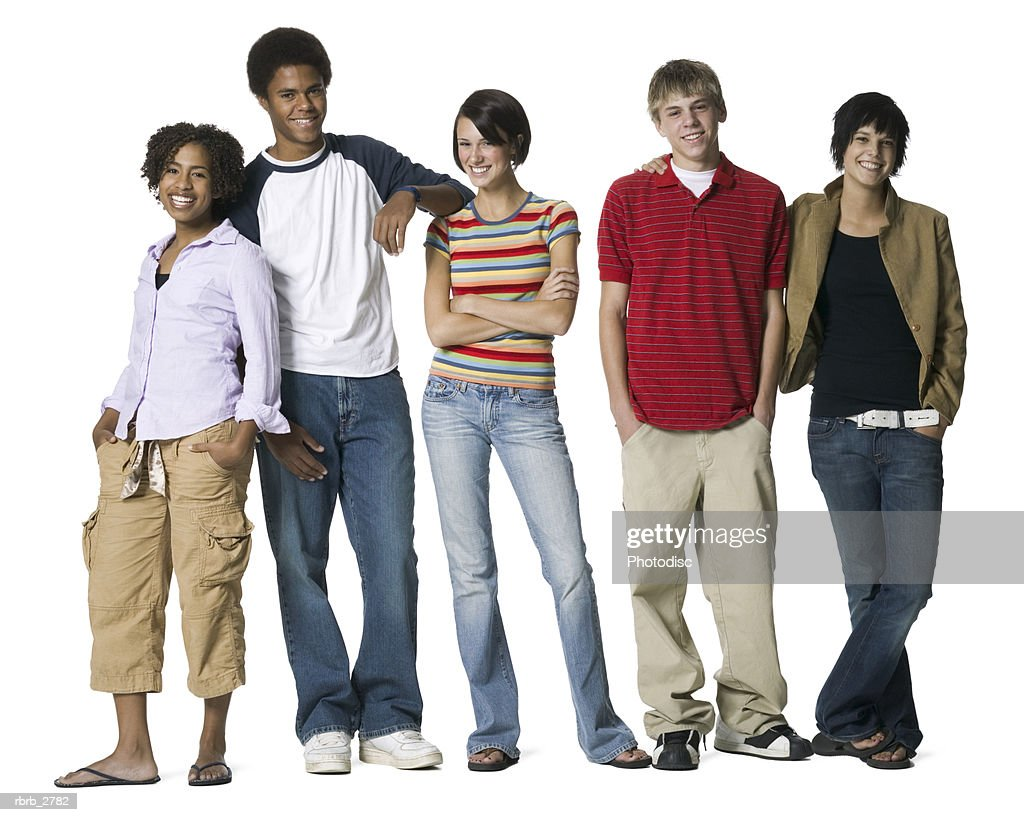 full length shot of a group of five teenage friends as they smile at the camera : Foto de stock