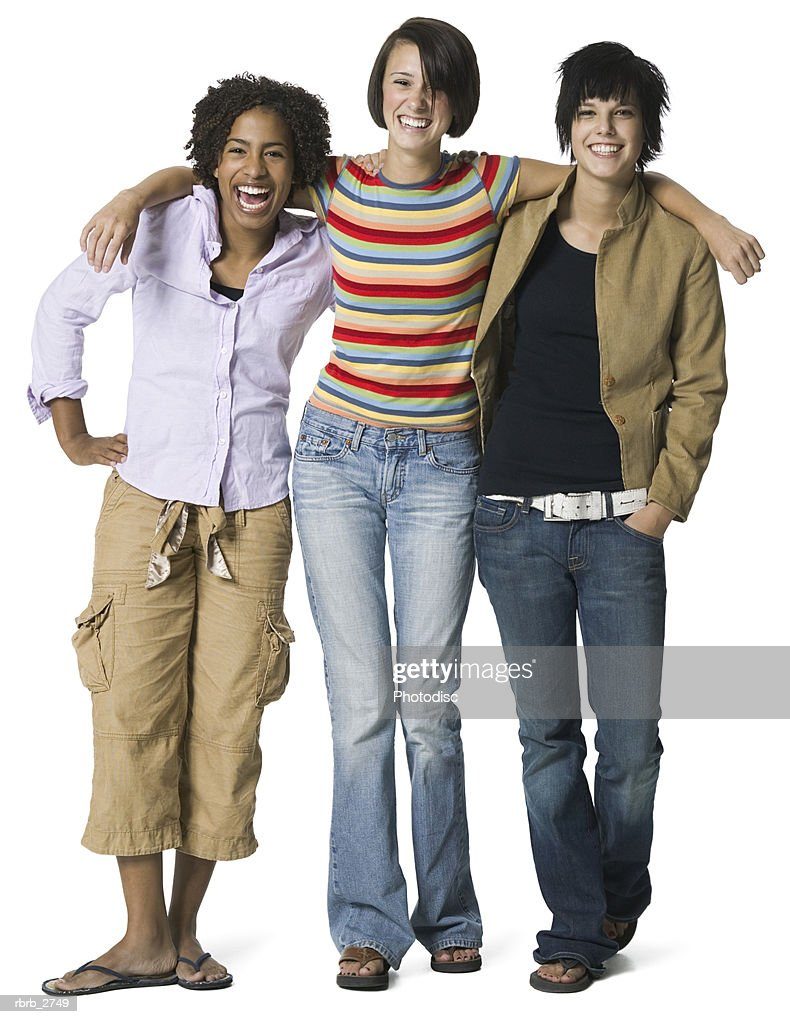 full length shot of a group of three teenage female friends as they smile at the camera : Stockfoto