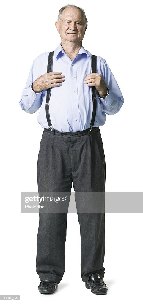 full length shot of a senior adult male in a blue shirt and suspenders as he smiles : Stockfoto