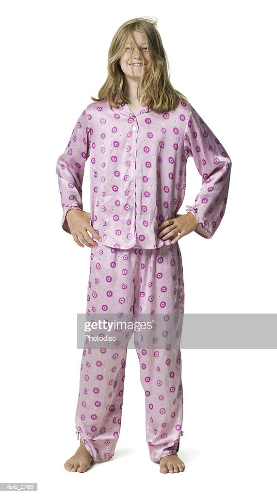 full length shot of a teenage female dressed in pajamas as she smiles : Foto de stock