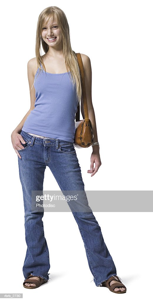 full length shot of a young adult blonde female in a blue shirt as she smiles at the camera : Foto de stock