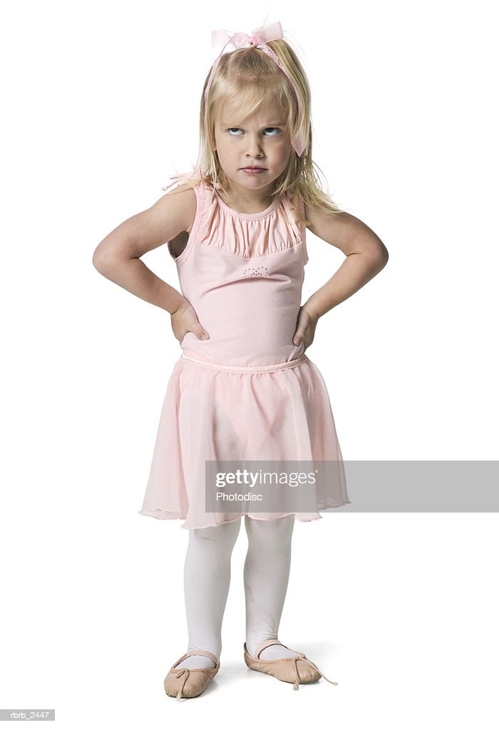 full length shot of a young female child in a pink ballet outfit as she acts annoyed : Foto de stock