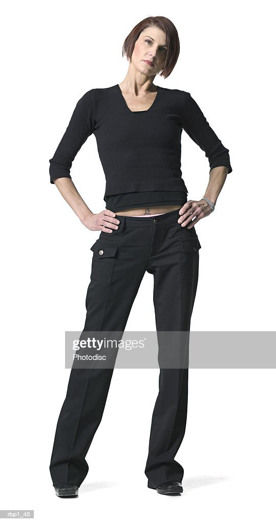 full length shot of an adult female in a black shirt as she glares at the camera : Stockfoto