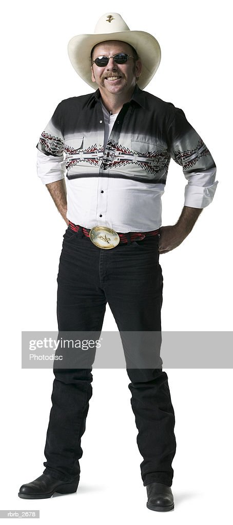 full length shot of an adult male in a cowboy shirt and hat as he looks at the camera : Foto de stock