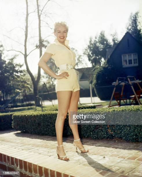 Full length shot of Betty Grable US actress dancer and singer wearing a yellow playsuit circa 1940