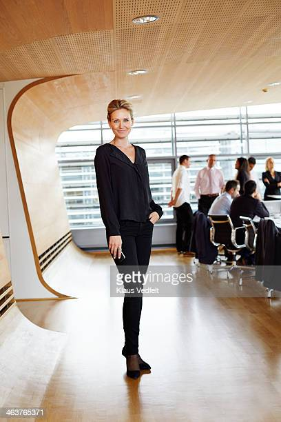 Full length shot of businesswoman at meeting