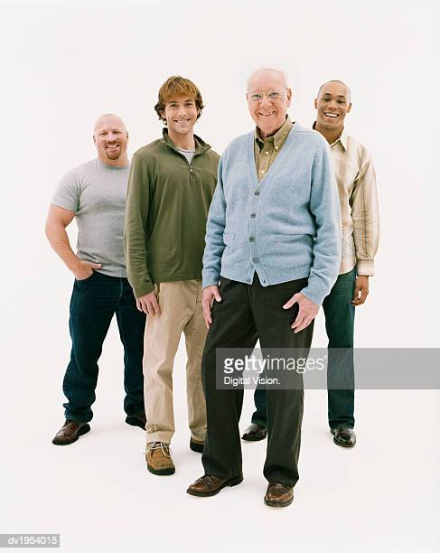 full length studio portrait of four smiling men of mixed ages - vier personen stockfoto's en -beelden