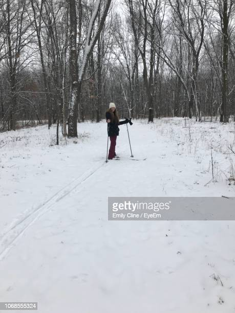 Full Length Teenage Girl Skiing On Snow Covered Field
