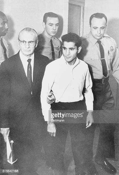 Full length view of Sirhan B Sirhan accompanied by his Attorney Rusell E Parsons and deputy sheriffs Sirhan the accused in the Robert F Kennedy...