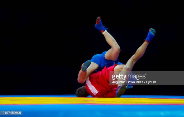 full lengths of athletes wrestling - cetkauskas stock pictures, royalty-free photos & images