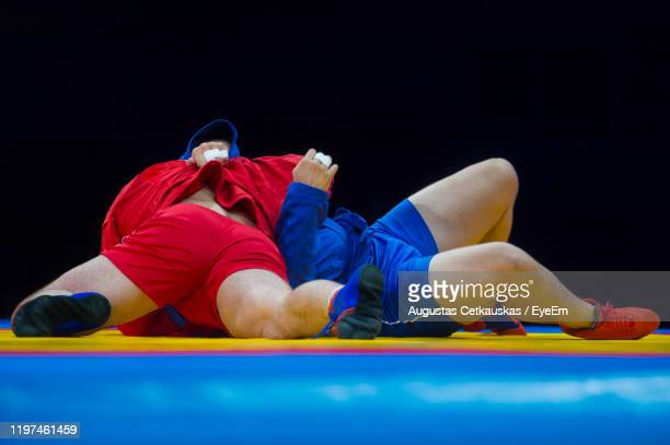 full lengths of athletes wrestling - wrestling stock pictures, royalty-free photos & images