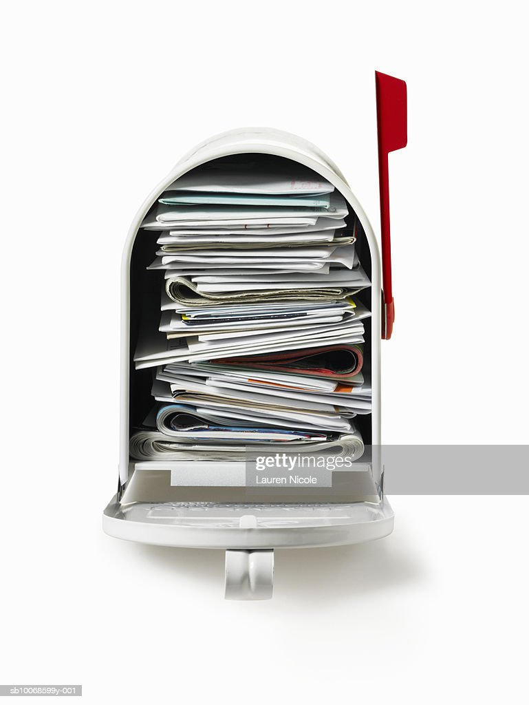 Full Mailbox With Red Flag In Up Position Studio Shot Stock Photo