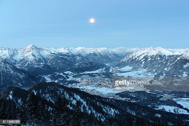 Full moon above tyrolean city