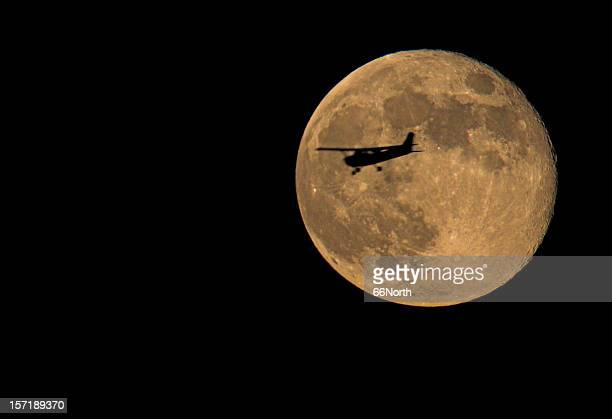 full moon & an airplane night evening lucky ufo - harvest moon stock pictures, royalty-free photos & images