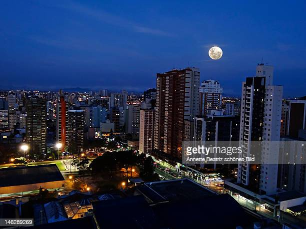 Full moon and cityscape