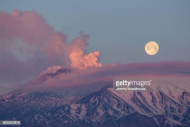 Full moon and clouds over mountains