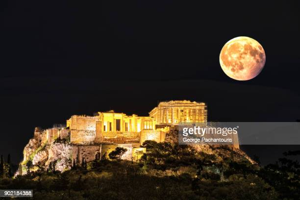 Full moon and the Acropolis in Athens, Greece
