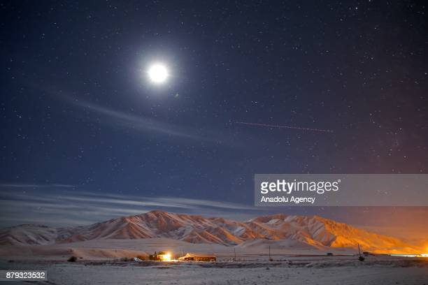 Full moon and the stars illuminate the sky over the Mount Artos on a cold autumn night after a heavy snowfall in Gevas District of Van province of...