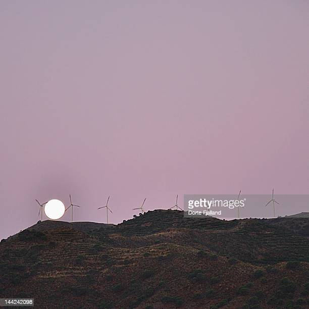 full  moon and windmills on mountain top - dorte fjalland stock-fotos und bilder