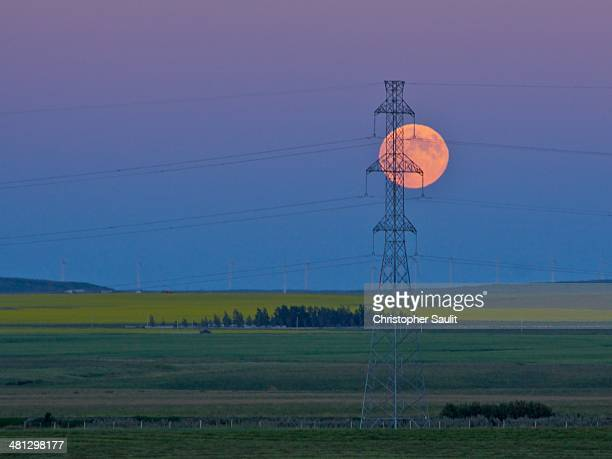 CONTENT] Full Moon as seen from southern Alberta Canada against a transmission tower