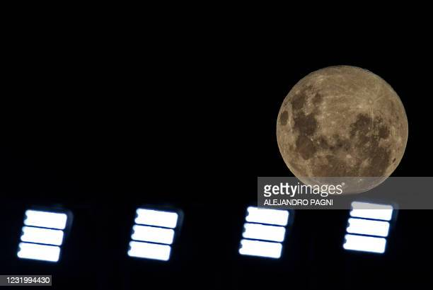 Full moon as seen from the Monumental of River Plate stadium in Buenos Aires, on March 28, 2021.