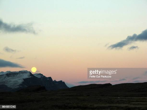 full moon at djupivogur, east coast iceland - austurland stock pictures, royalty-free photos & images
