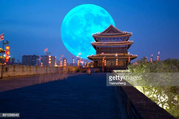 full moon at xian old city wall building,which was built several years ago,china - yunnan province stock pictures, royalty-free photos & images