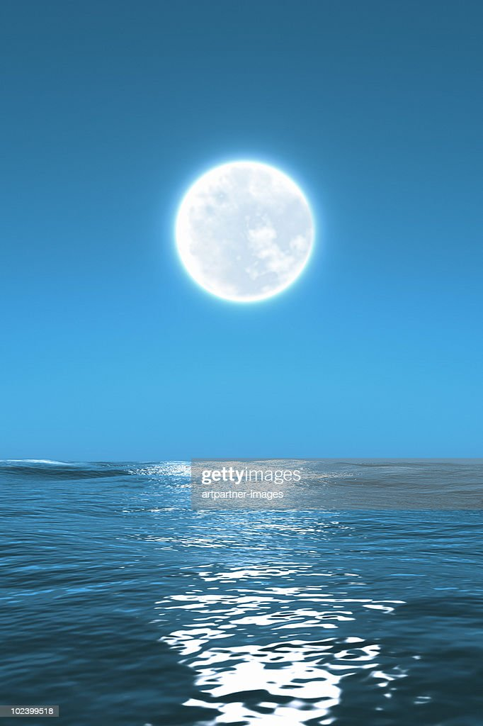 Full Moon Glow Shinning With The Sea At Night Stock Photo