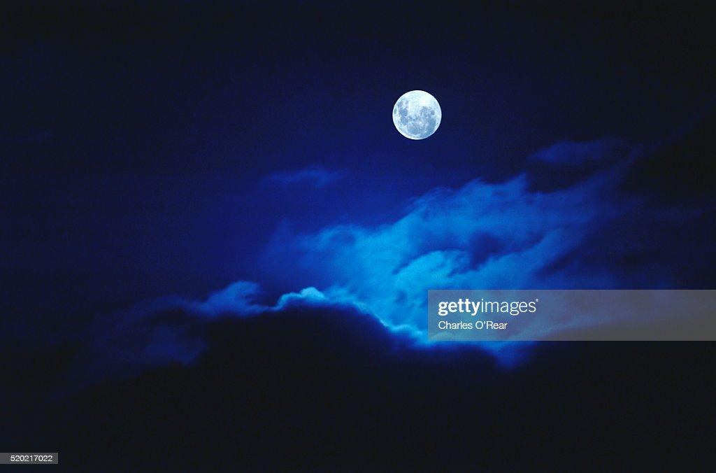 Full Moon Illuminating Clouds : Stock Photo