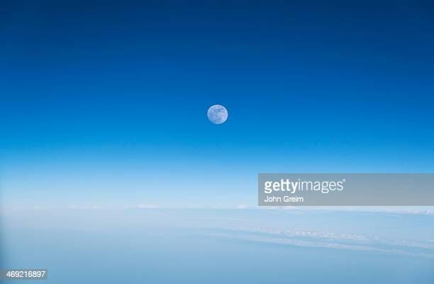 Full moon in a blue sky