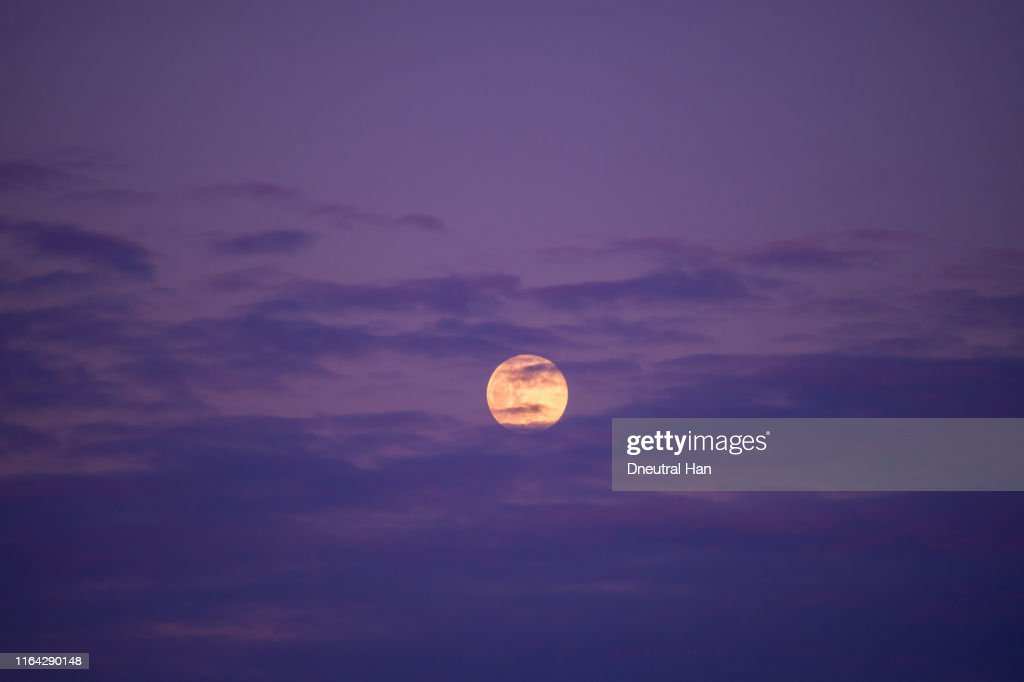 Full Moon in the sunset cloud in the purple sky : Stock Photo