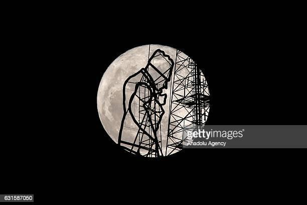 Full moon is seen behind the ironmade silhouette of Mustafa Kemal Ataturk founder of Republic of Turkey on December 12 2017 in Van Turkey