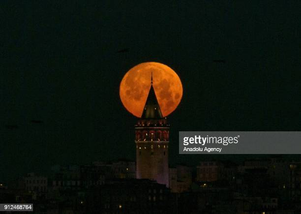 Full moon is seen over Galata Tower in Istanbul Turkey on January 31 2018