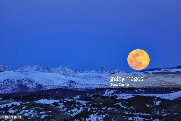 full moon mountain supermoon - gore range stock photos and pictures